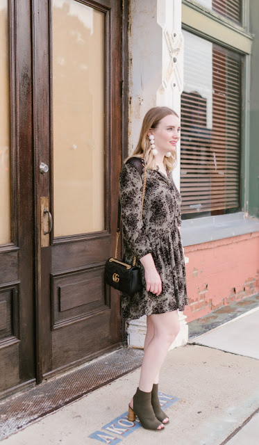 Memphis Fashion Blogger Megan shares a cute Hinge dress paired with statement earrings and a Gucci crossbody bag. The perfect dress for Summer.